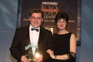 Mary Fran Johnson, editor in chief of Computerworld, presents Premier 100 IT Leader Award to John DeAngelo.